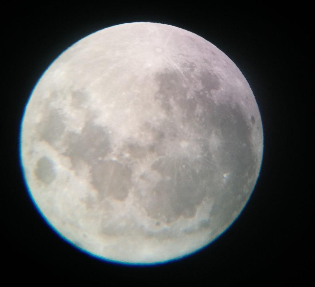 Full moon photo taken through a telescope.