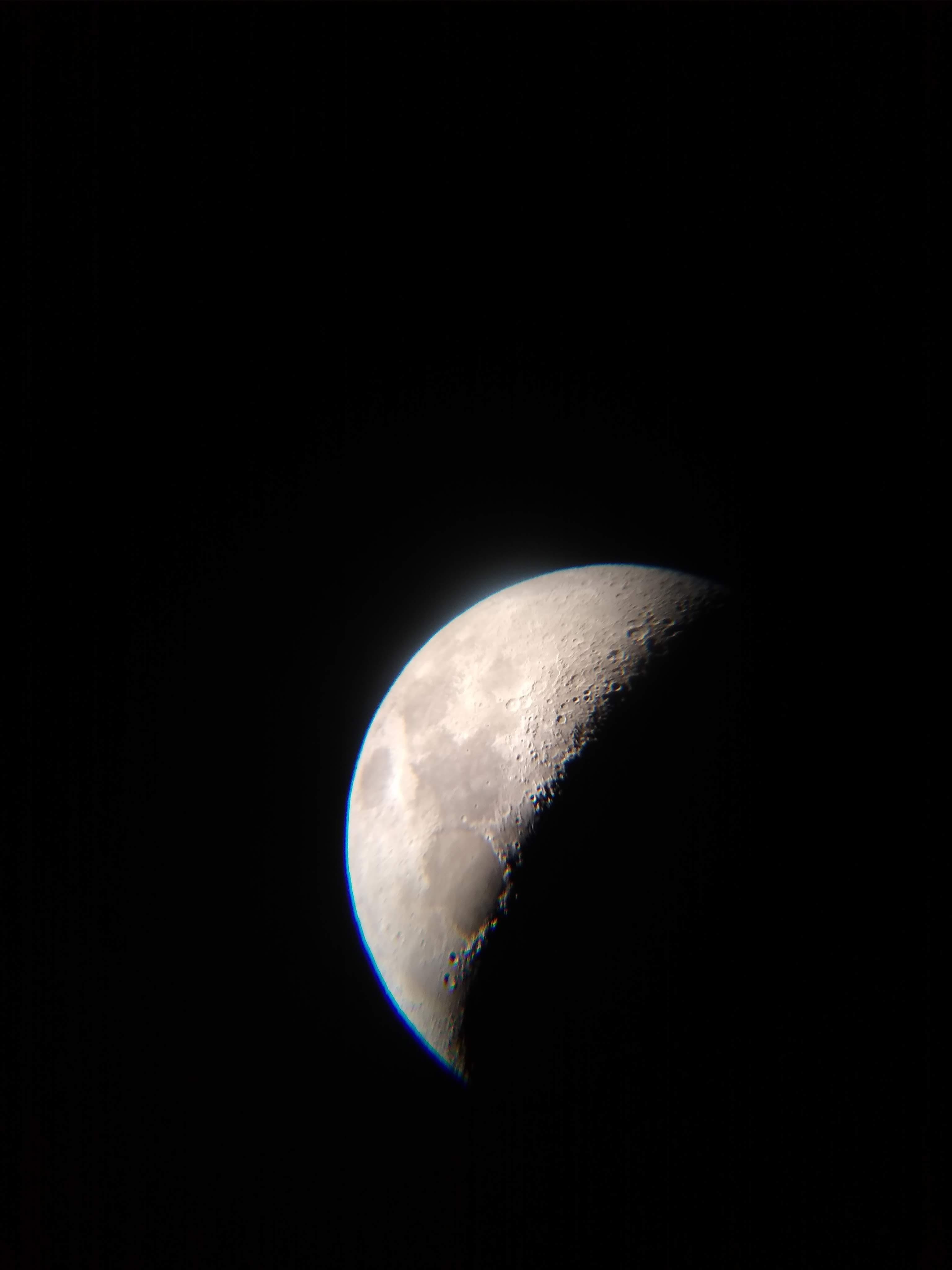 Quarter moon picture taken through a telescope