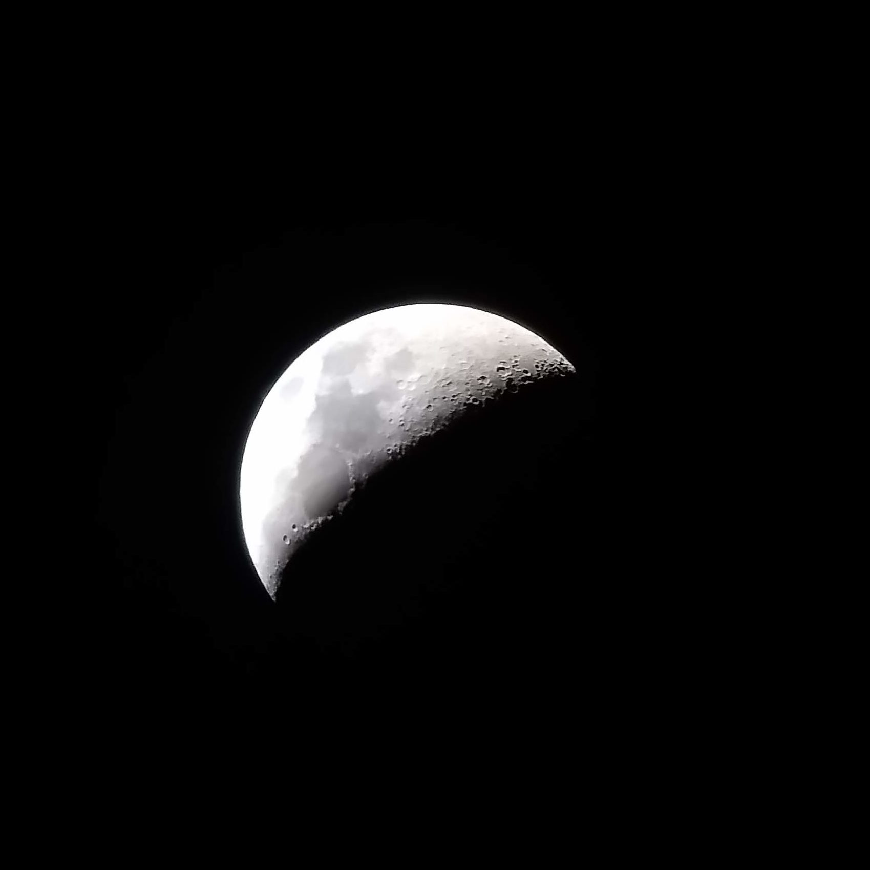 Quarter moon picture taken through a telescope